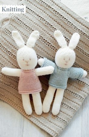 Knitted boy and girl bunny toys