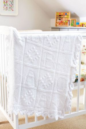 Knitting baby blanket with ABC motif