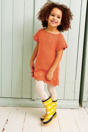 Orange knitted girl's dress with asymmetric hem