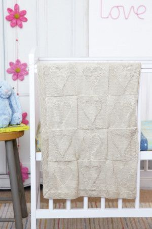 Knitted baby blanket with all-over heart motif