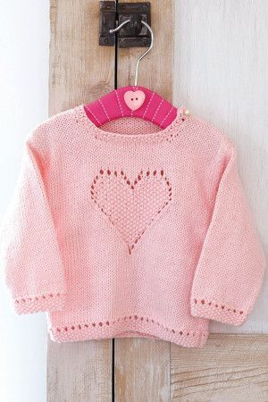Knitted pink sweater for little girls with heart design on front