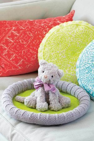 Knitted grey and lime cat bed