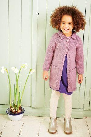 Little girl wearing purple knitted coat