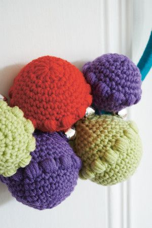 Round crocheted puff stitch baubles for Christmas in red, green and purple