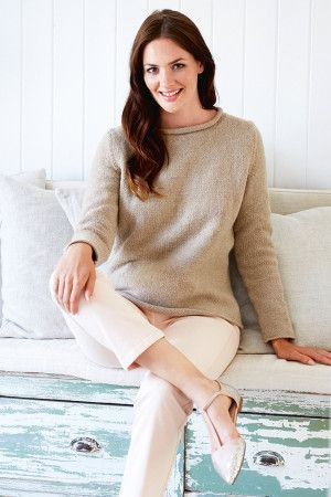 Ladies' knitted jumper with neck roll
