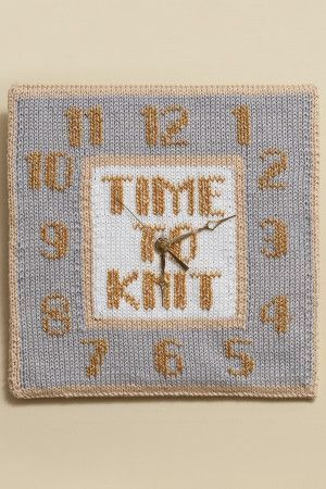 Knitted clock face with Time To Knit and numbers Swiss darned