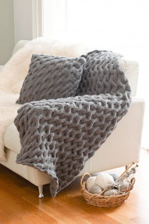 Large knitted easy cable knit throw in putty colour