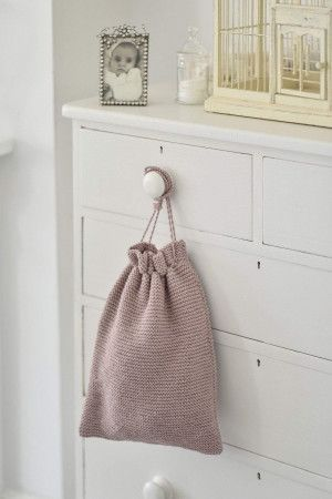 knitted drawstring bag in garter stitch ideal for the nursery