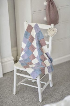 knitted patchwork baby blanket in three colours