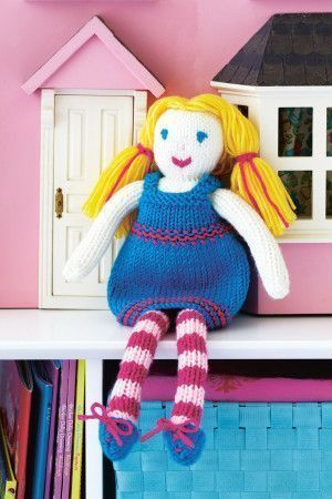 Knitted dolly with blonde hair, blue dress and striped tights