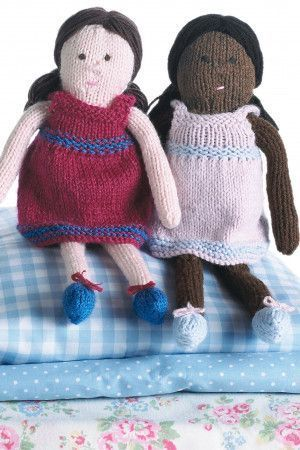 Two knitted dolls in striped dresses and pretty shoes with bows