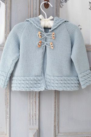Knitted jacket for a baby with toggle fastening and cable trim