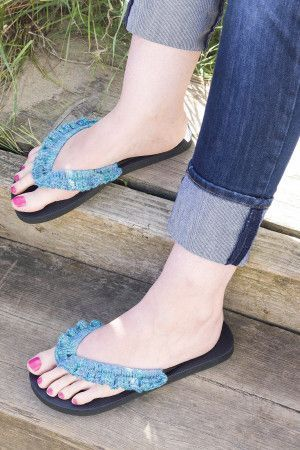 Flip flops with a decorative frilly crochet trim