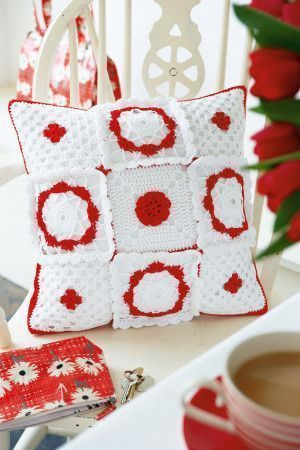 Scandinavian style crocheted cushion cover with floral motifs