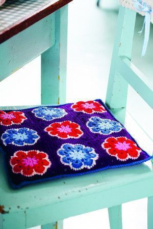 Red, pink, purple and blue crocheted chair cover