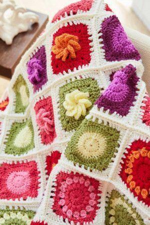Flower Garden blanket with crocheted daisies