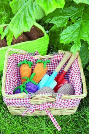Crocheted toy vegetables and trough with soil