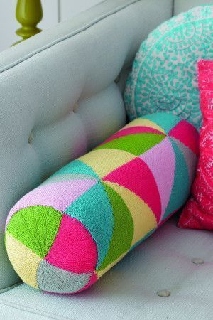 Knitted bolster cushion with a geometric pattern