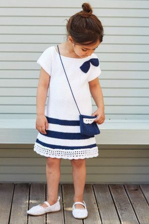 Blue and white girl's knitted dress with bow
