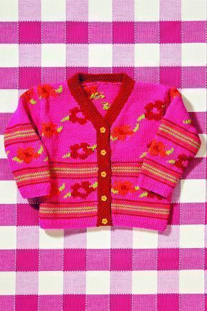 Knitted cardigan for girls decorated with stripes and flowers