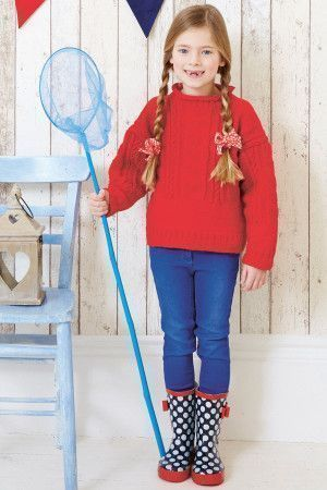 Knitted cable sweater for a girl with roll neck and long sleeves