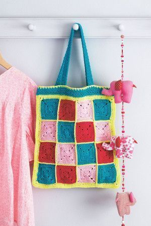 Brightly coloured crocheted granny square bag