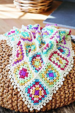 Original granny blanket with a pompom trim