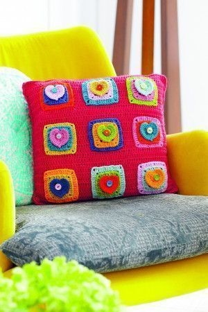 Colourful crocheted cushion with hearts