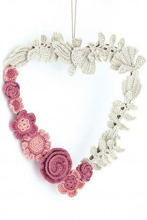 Crocheted heart decoration with assortment of flowers in pinks and white