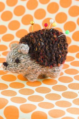 Small knitted hedgehog pin cushion