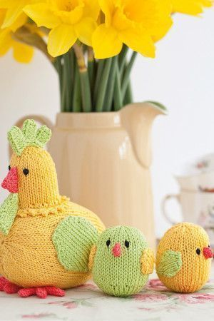Knitted mother hen and two little chicks in green, yellow and orange