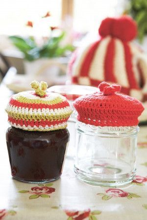 Crocheted covers for jars of jam or pickles in bright yarn