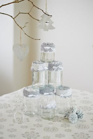 Crocheted jar covers in white and silver with bows and texture