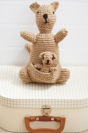 Retro knitted kangeroo with baby in pouch from 1960s
