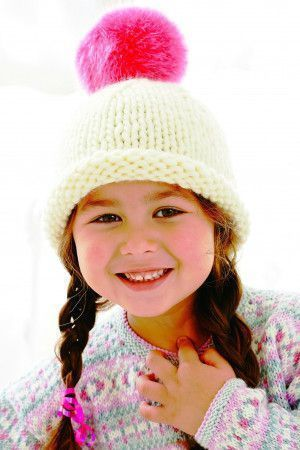 Children's knitted beanie hat with a fluffy bobble