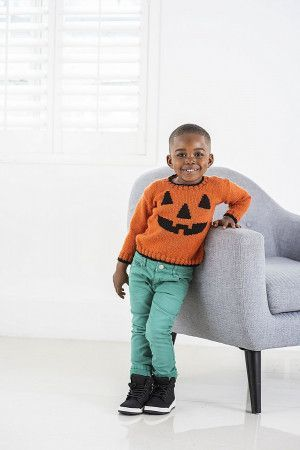 Childs orange and black knitted sweater pattern with pumpkin face motif