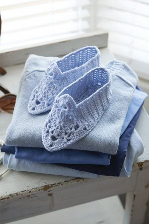 Crocheted slippers for women with floral fronts