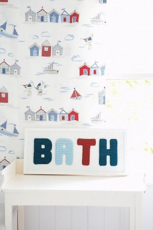 Crocheted letters B A T H to make a bathroom sign