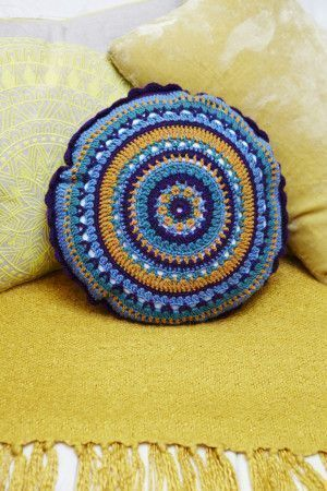 multi coloured round crochet cushion