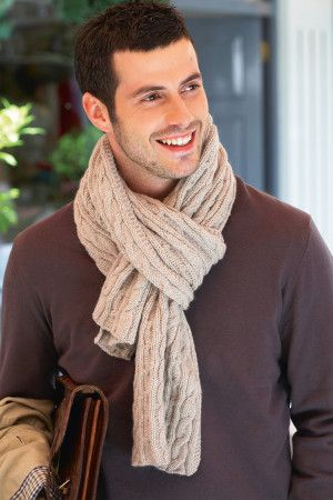 Cable knitted scarf for a man shown in biscuit colour yarn