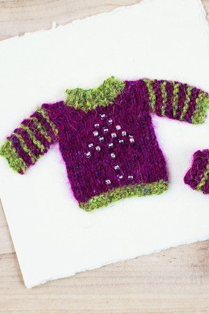 Small knitted Christmas jumper with beads