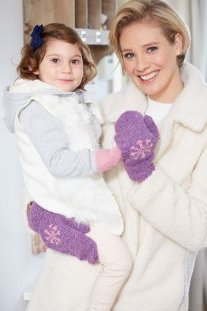 Women's knitted mittens with pink snowflake motif and girl's co-ordinated plain mittens