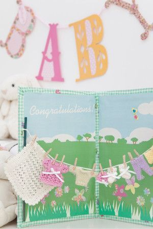 Washing line of tiny baby knits on new baby greetings card