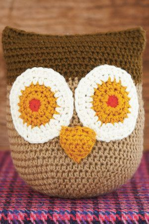 Crocheted owl toy with big round eyes and beak
