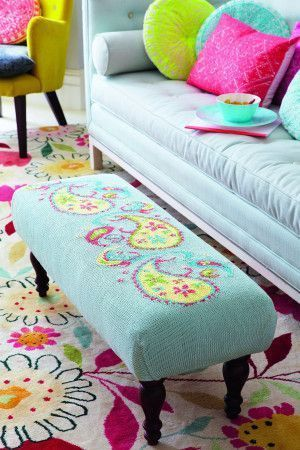Pale blue footstool with a colourful paisley pattern