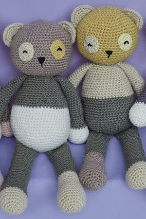 Crochet panda toy with big eyes and long arms and legs