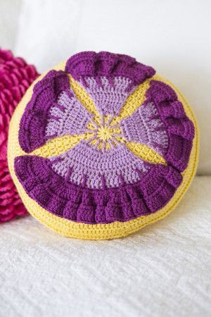 Crocheted round purple and yellow pansy cushion