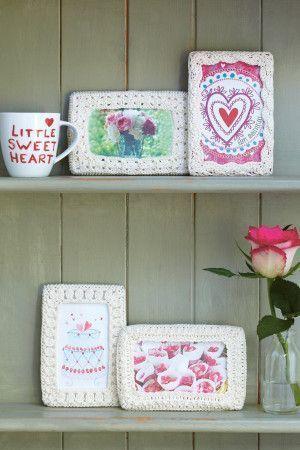 Four crocheted photo frame designs in cream yarn