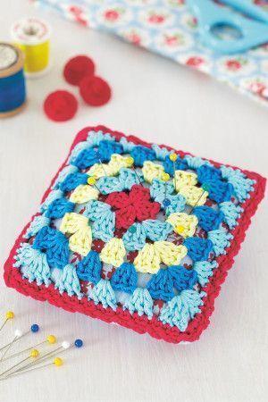 Crocheted multi-coloured pin cushion