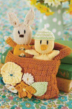 Knitted toy chick and rabbit in basket with floral motif